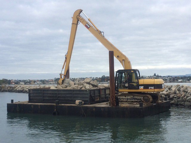 Dredging yellow digger workboat